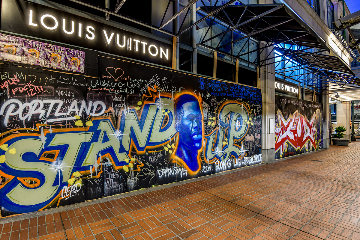 "A mural outside Lous Vuitton in Portland says ""Portland Stand Up."""