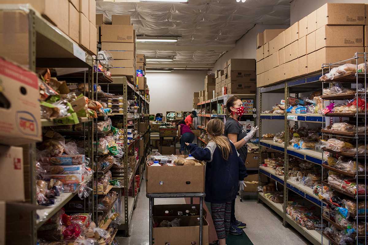 Volunteers at Portland Adventist Community Services fill grocery boxes