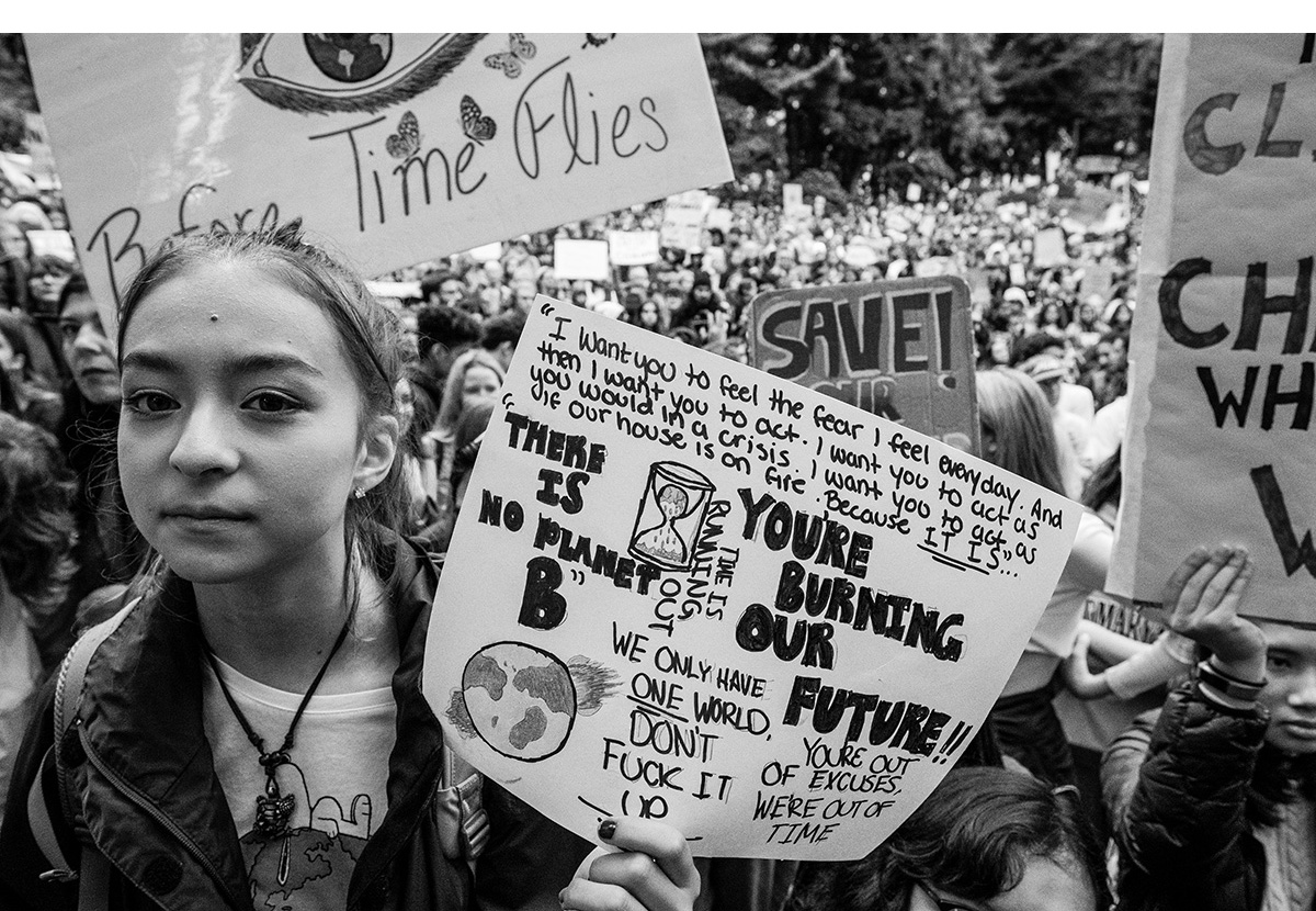 """Protest signs encouraging adults to """"feel the fear"""" that the youths feel about their future were abundant."""