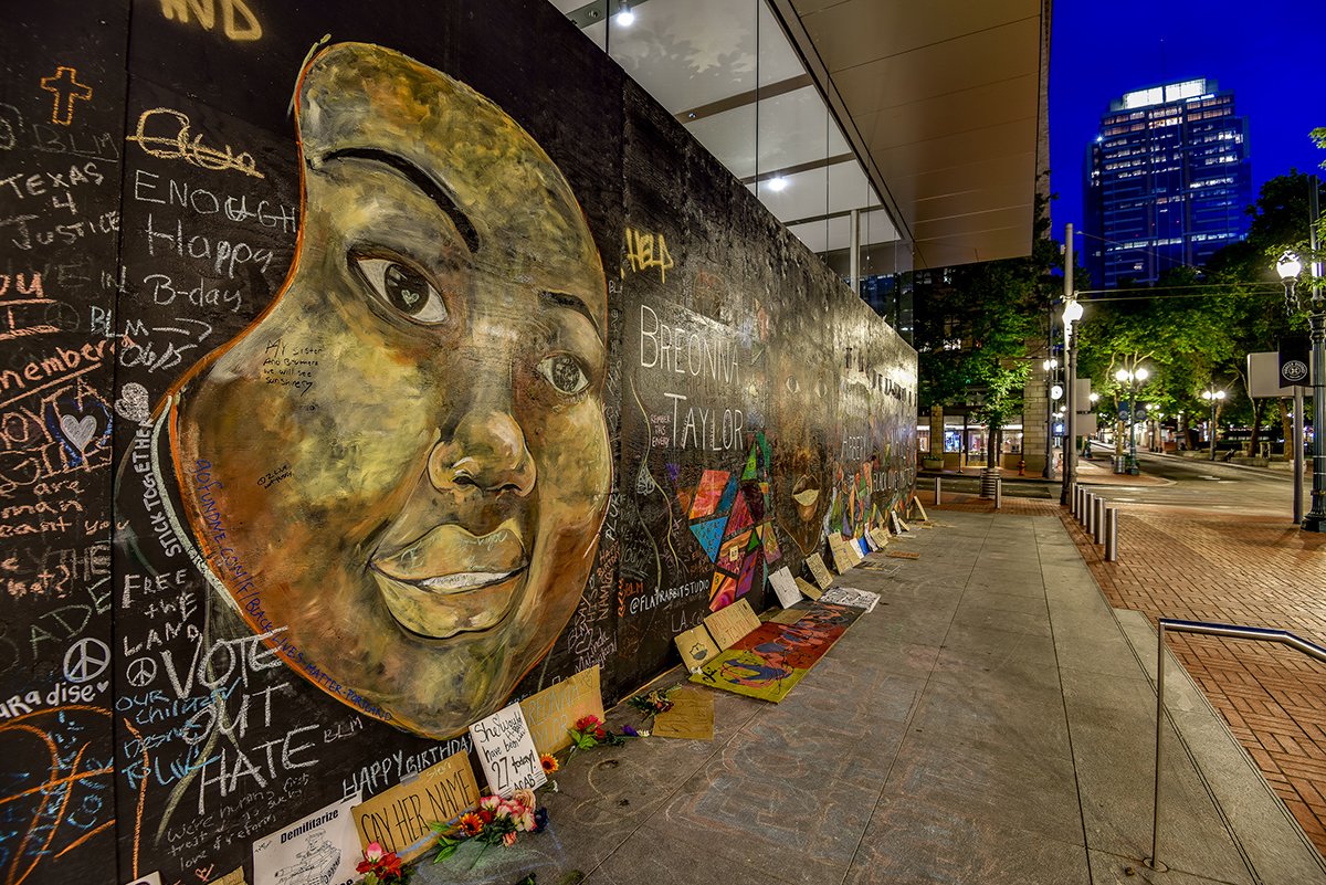 A mural outside the Apple Store in downtown Portland features an image of Breonna Taylor.