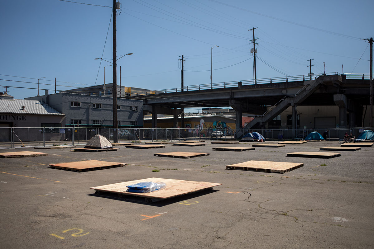 Platforms spaced 10 feet apart for tents at the LGBTQ+ camp