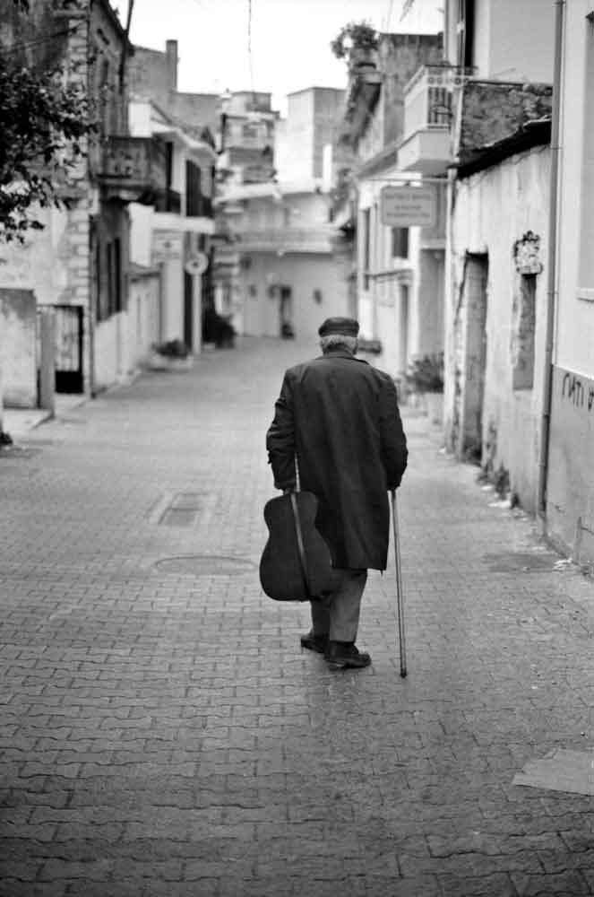 """This photo from Greece is from """"Music on the Road,"""" a photography collection by Vassilis Koltoukis featuring street musicians from dozens of countries."""