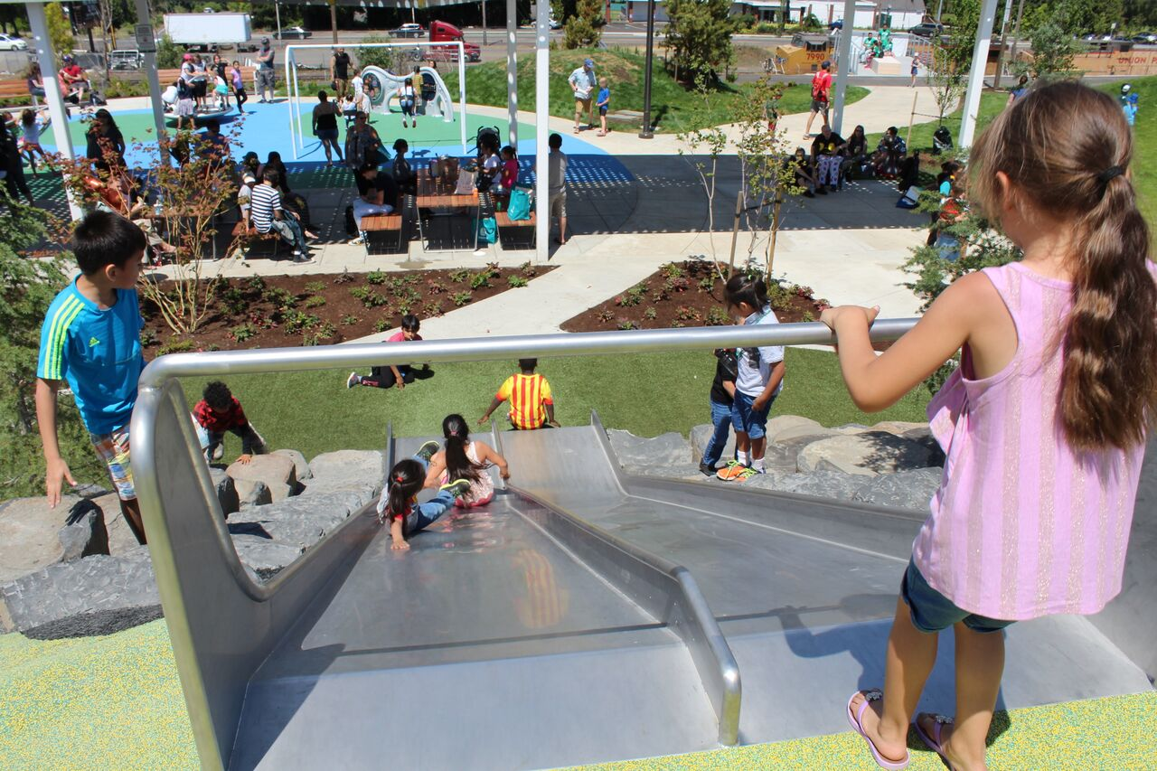 Children enjoy the slide at the new Cully neighborhood park.