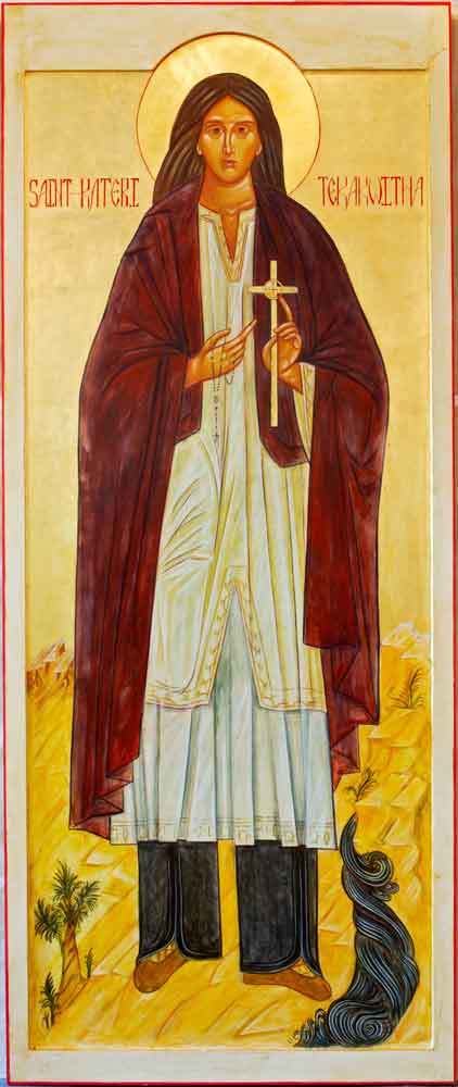St. Kateri Tekawitha, an icon created by Mary Katsilometes, features the tunic and leggings of the Algonquin people, surrounded by elements of the earth, plants and water. The icon hangs in the church at the St. Paul Mission in La Conner, Wash., on the Sw
