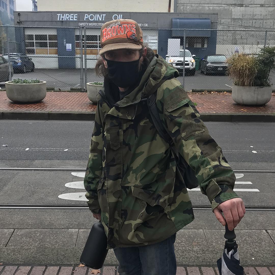 James Robinson aka Cleveland wears a protective mask