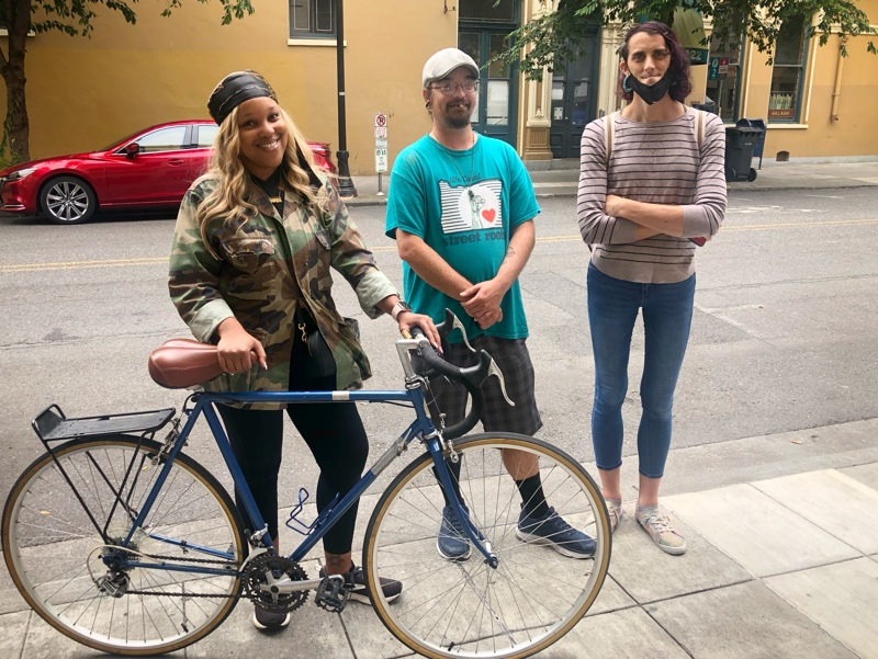Eboni Brown stopped by to chat with Doug Marks and Raven Drake in front of the Street Roots office
