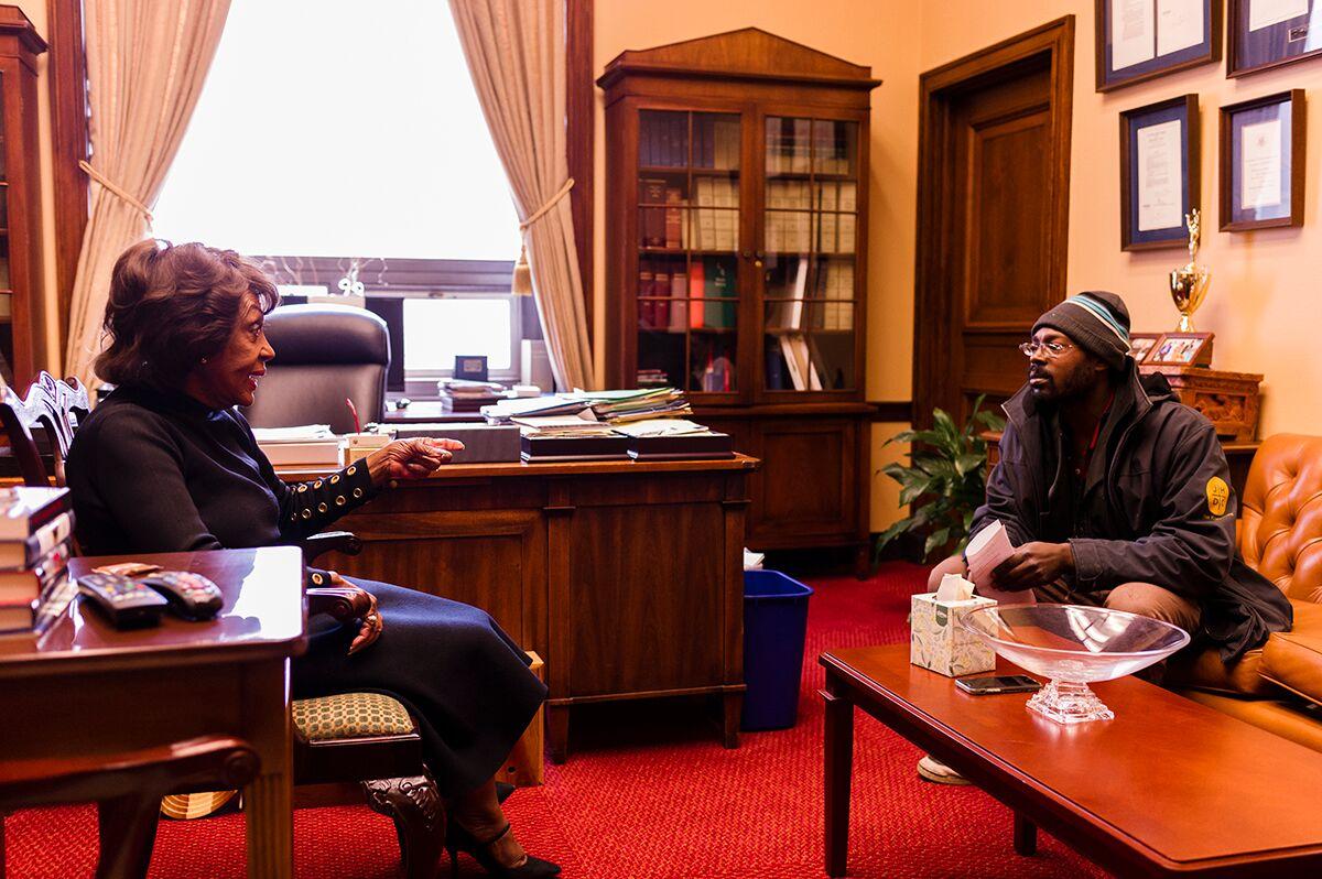 Street Sense Media vendor Reginald Black interviews United States Representative Maxine Waters.