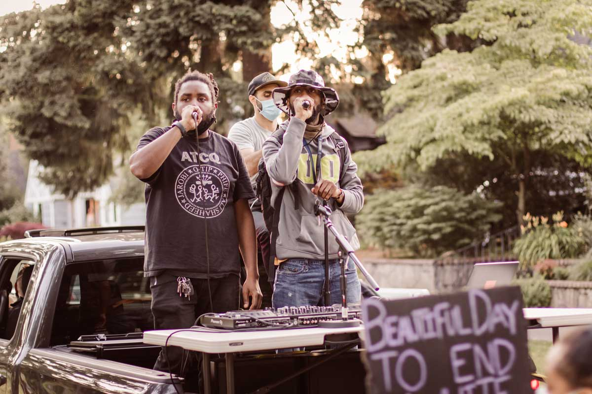 Kevin, a DJ, and Rell, perform in the back of a pick-up truck alongside protesters who were marching to Portland Police Bureau's North Precinct on June 26.