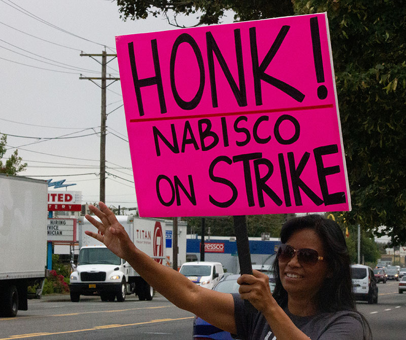 "Nabisco worker Tina Bryan holding a sign that says, ""Honk! Nabisco on Strike"""