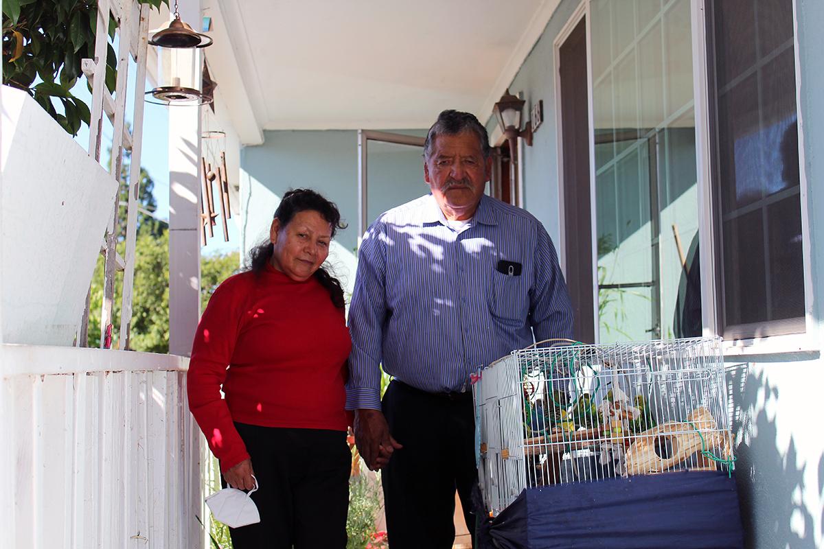 Maria and Antonio Diaz with their parakeets