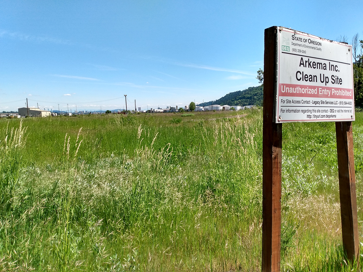 Sign reads: Arkema Inc. Clean Up Site. Unauthorized entry prohibited.