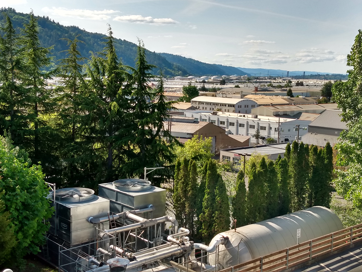 Industrial structures, such as tanks, are seen in Portland's Northwest Industrial District
