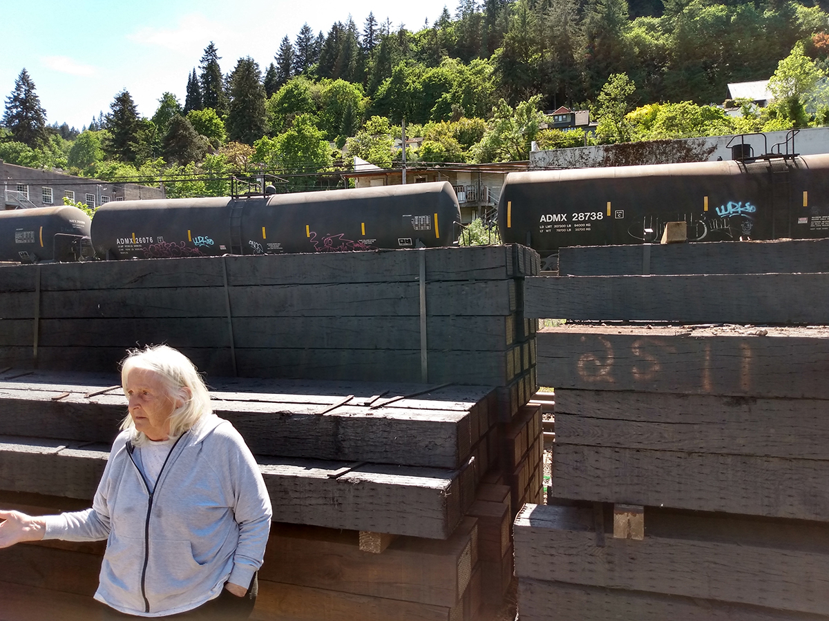 Sarah Taylor stands in front of tanker cars
