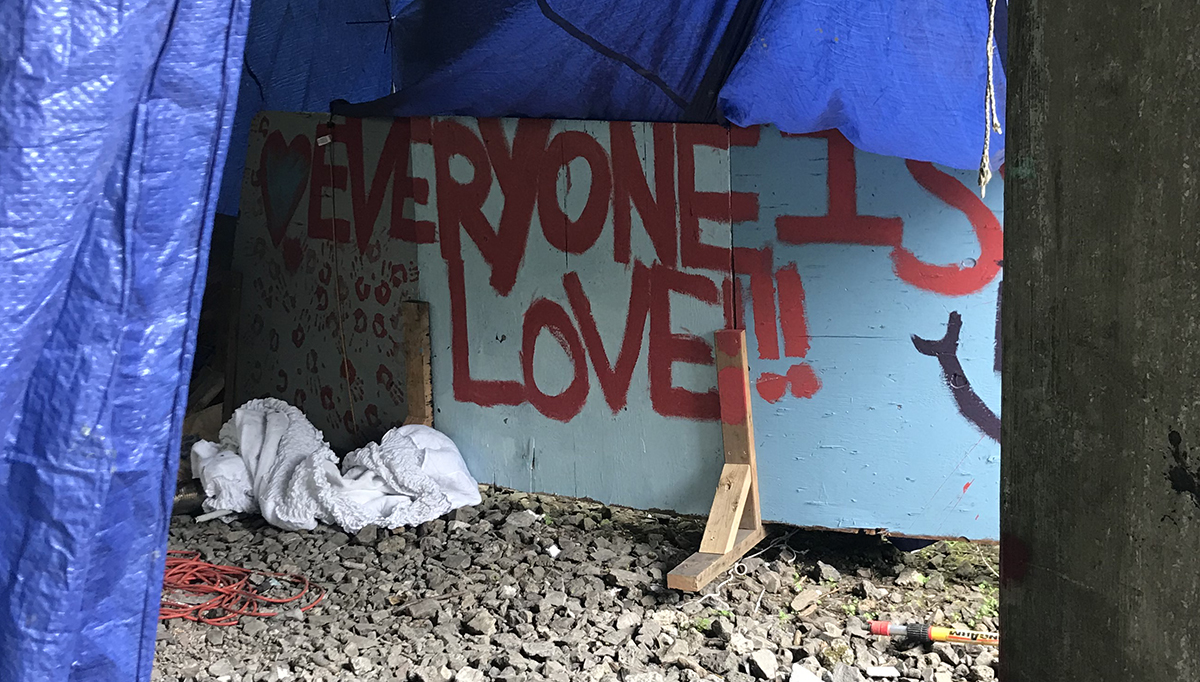 A sign reads: Everyone is love