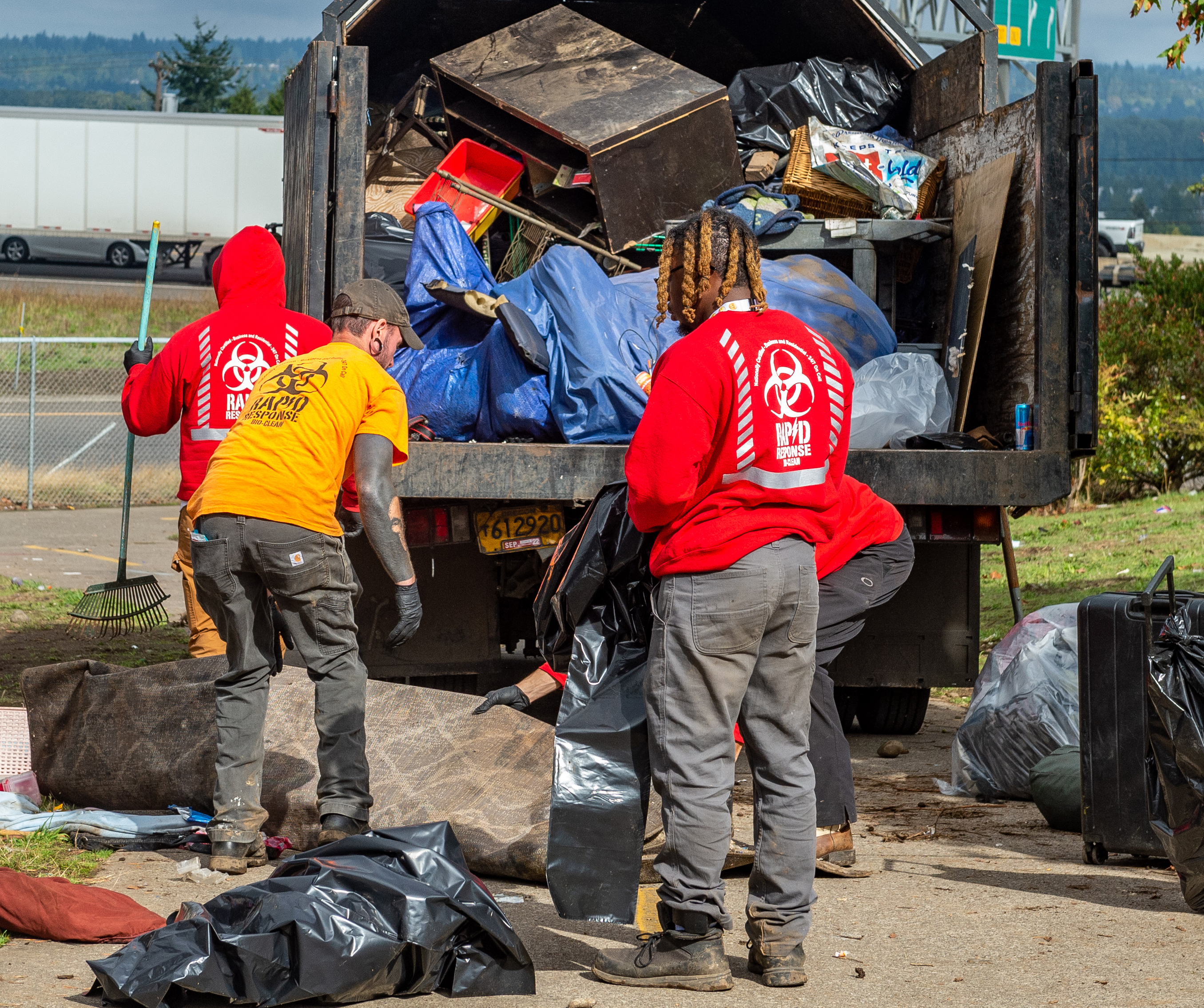 Photo of a Rapid Response BioClean collects trash during an encampment sweep.