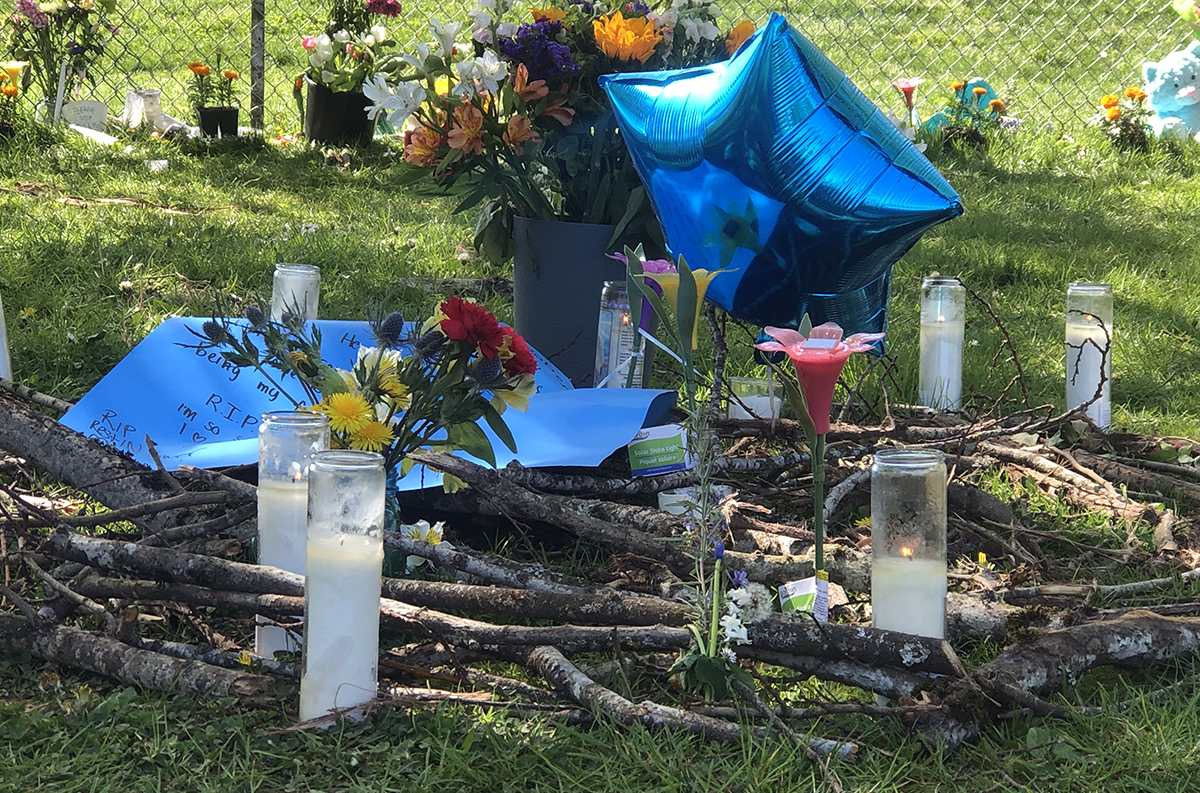 Balloons and candles at Robert Delgado's memorial