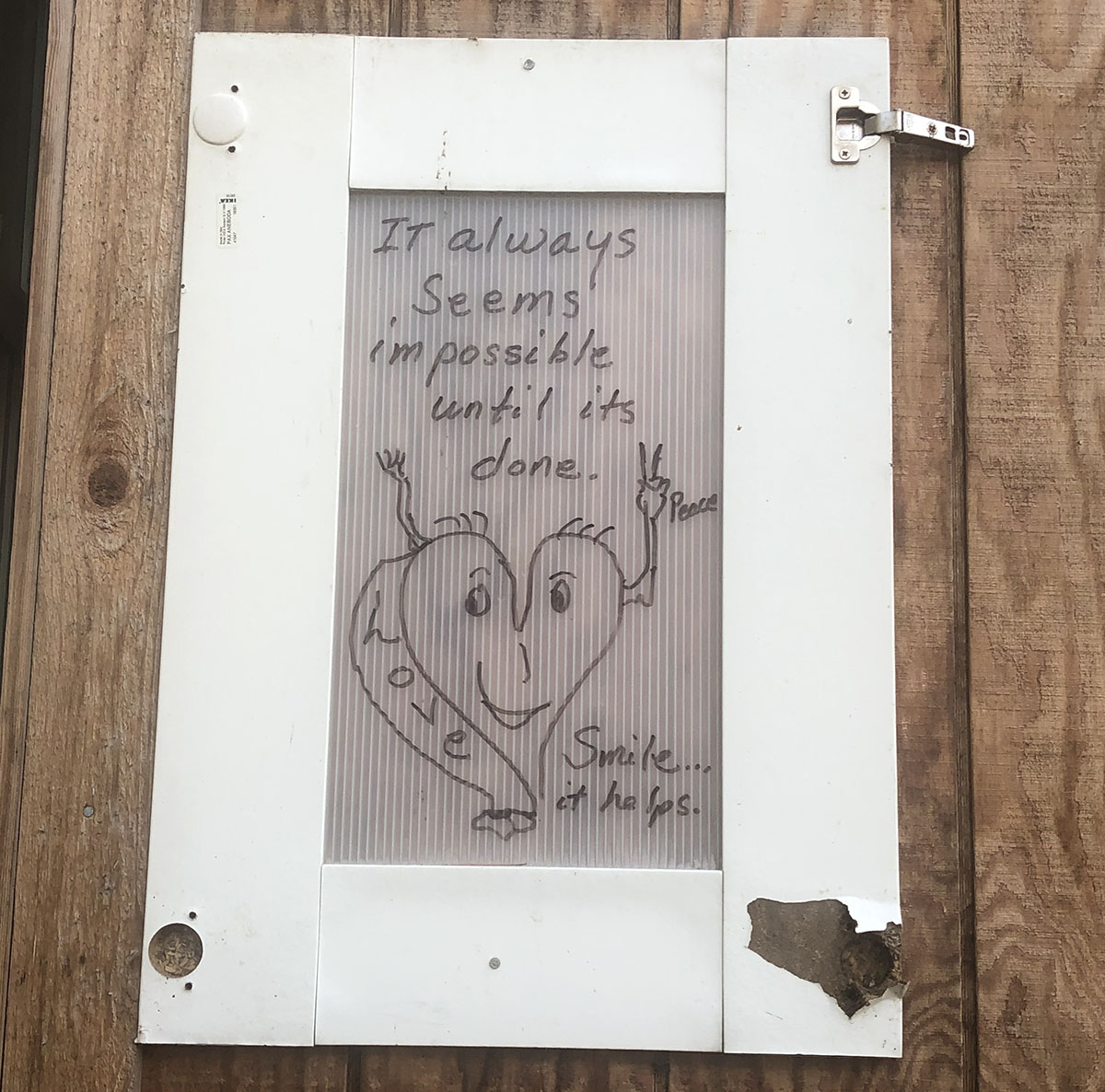 Handmade sign reads: It always seems impossible until its done