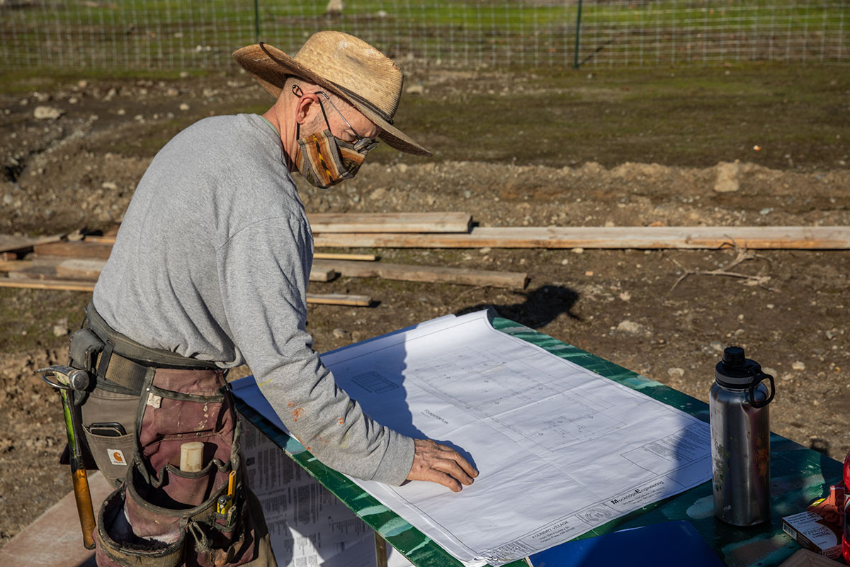 Doug Walker looks at plans at the Foundry Village site