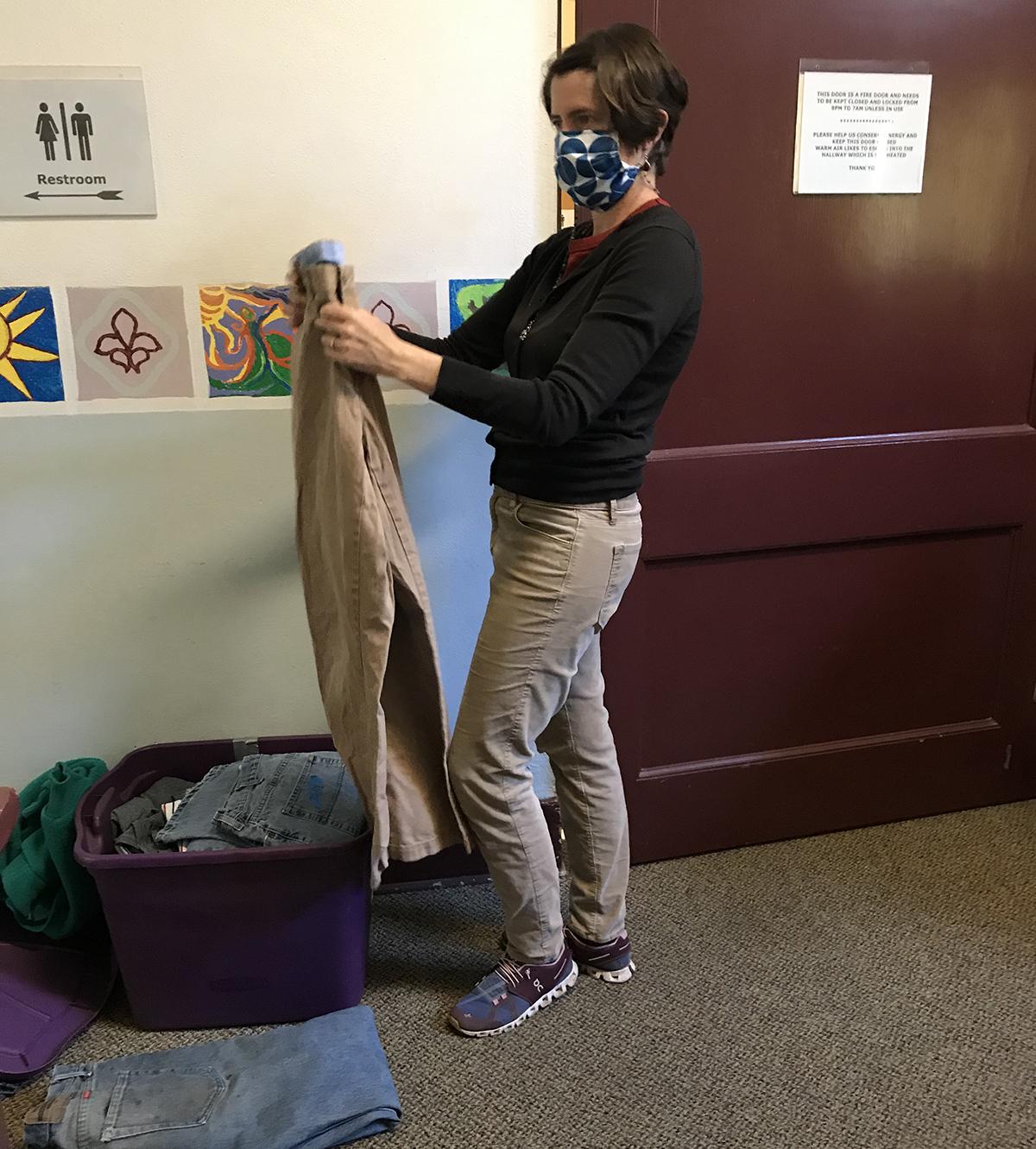 Hannah Wallace picks up a pair of pants