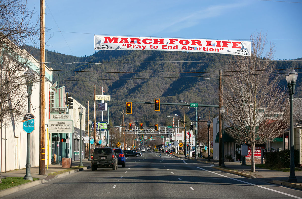 A banner above the street reads: March for Life. Pray to end abortion.