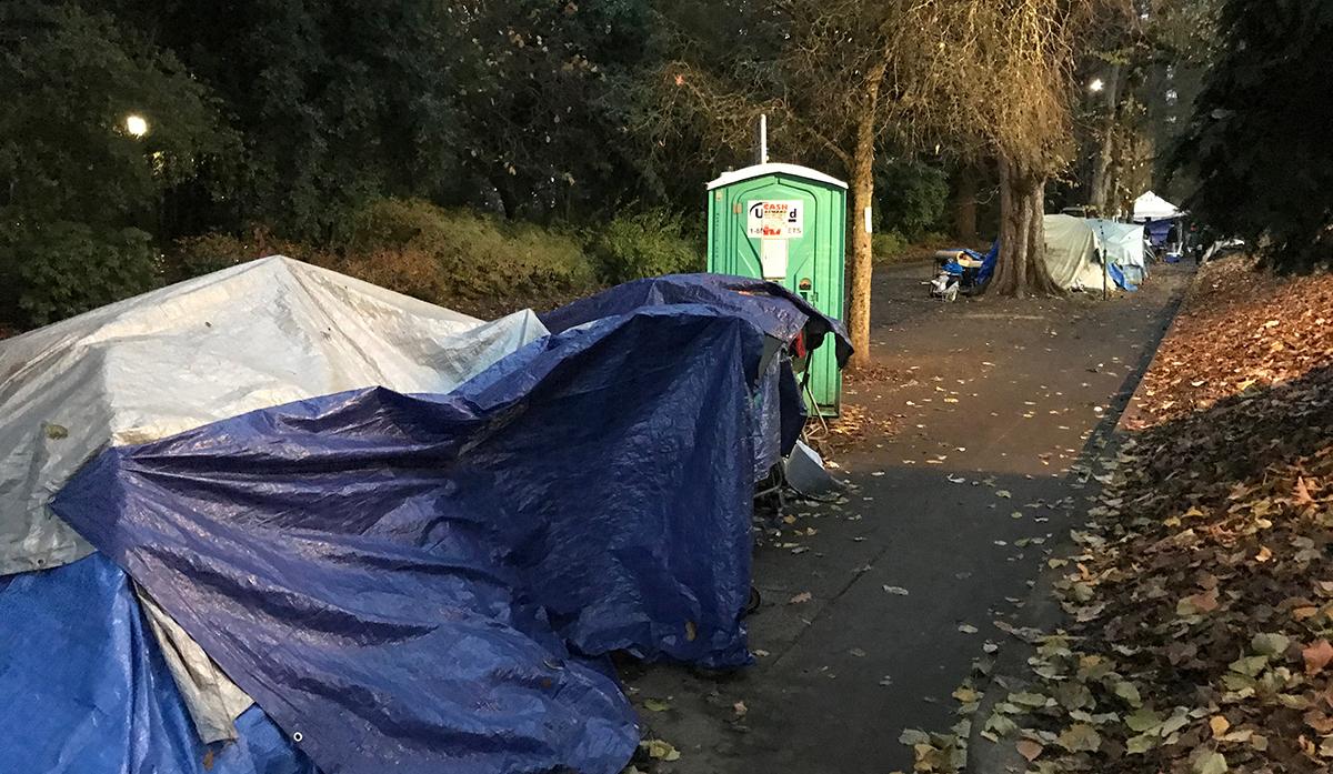 A few tents line the sidewalk along Laurelhurst Park