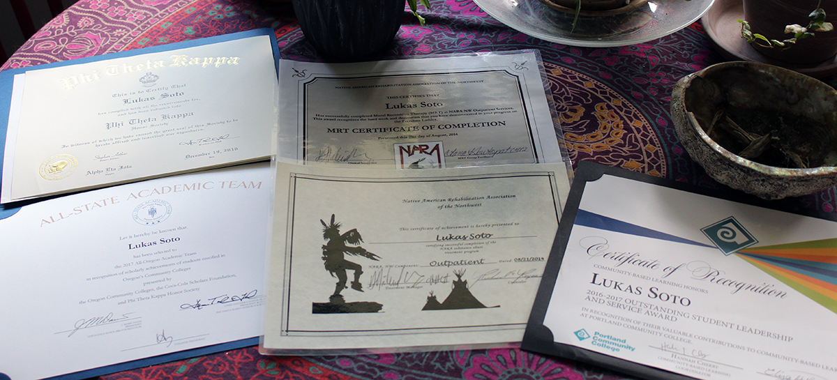 Honors certificates spread out on a table