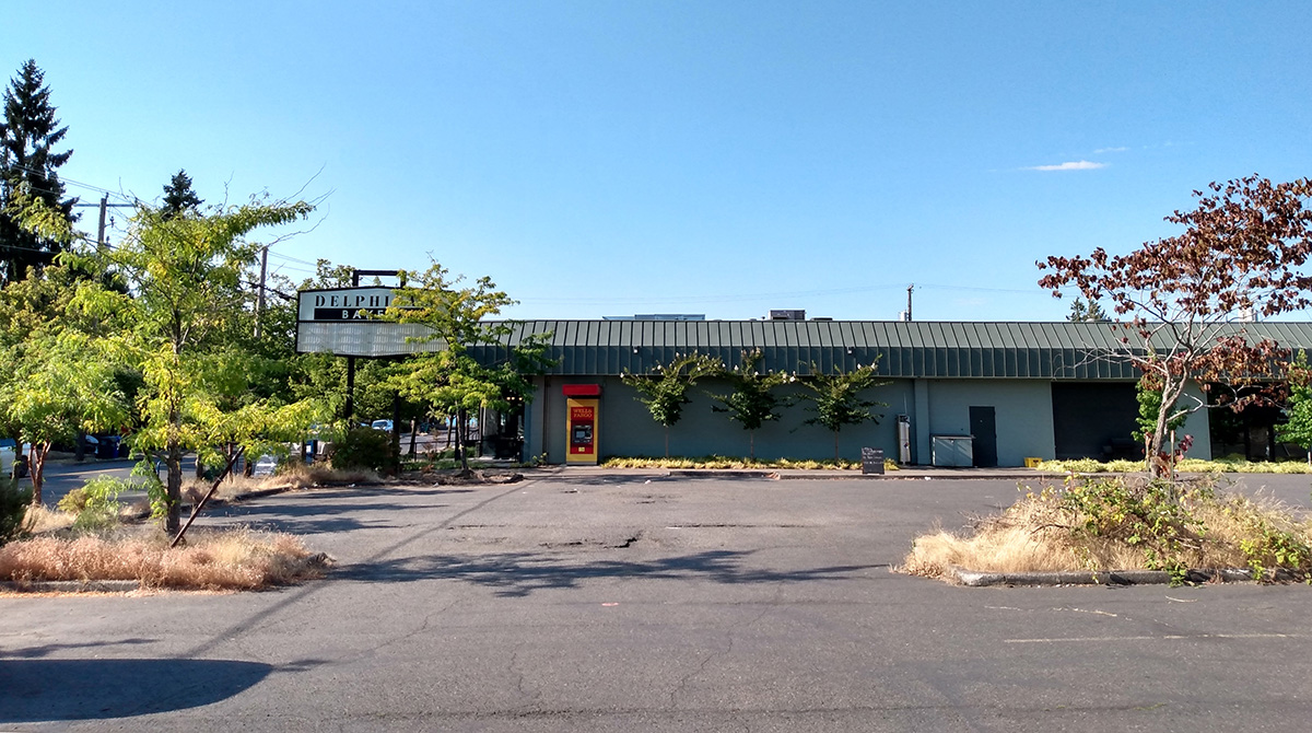 Delphina's Bakery building and an empty parking lot