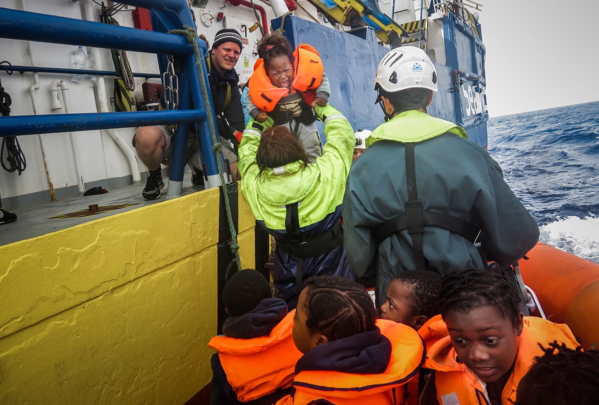 People being rescued aboard a ship