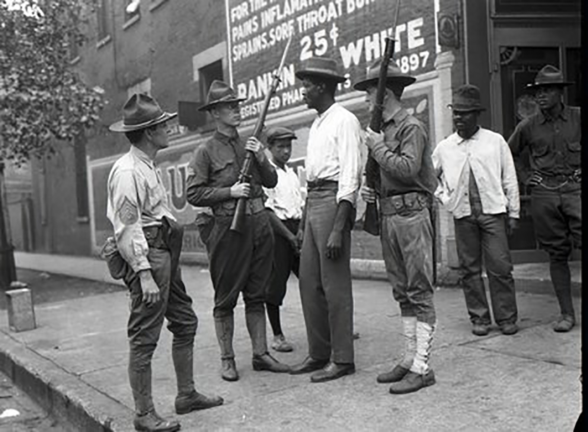 Historical photo of armed guards with Black men in Chicago