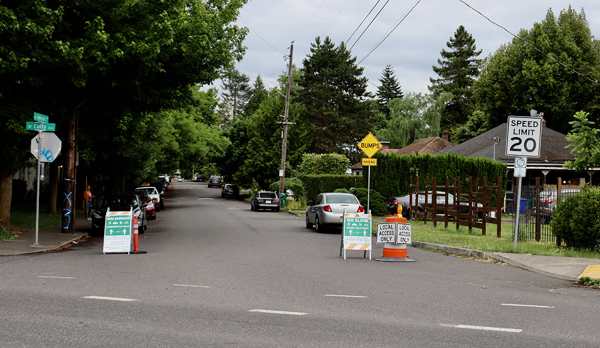 Signs are posted, along with cones, at the intersection of Northeast Emerson Street and Cully Boulevard