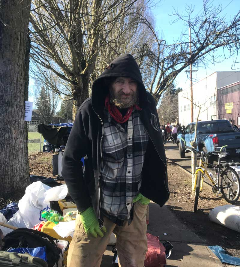 Scott Rupp stands near his campsite on the sidewalk near Sunnyside Environmental School.