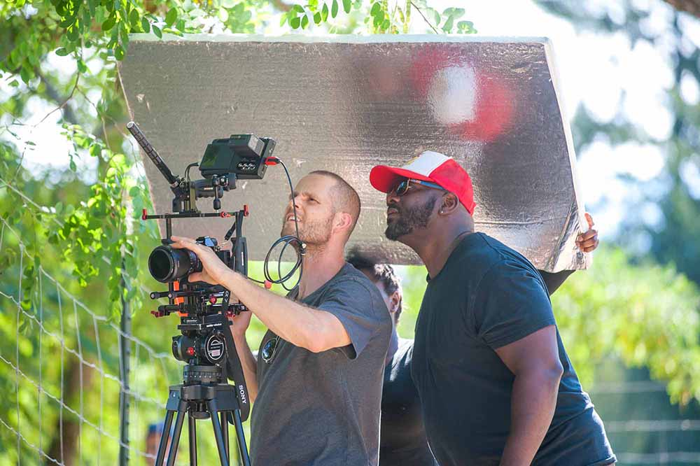 """""""Red, White and Black"""" director checks the lighting"""