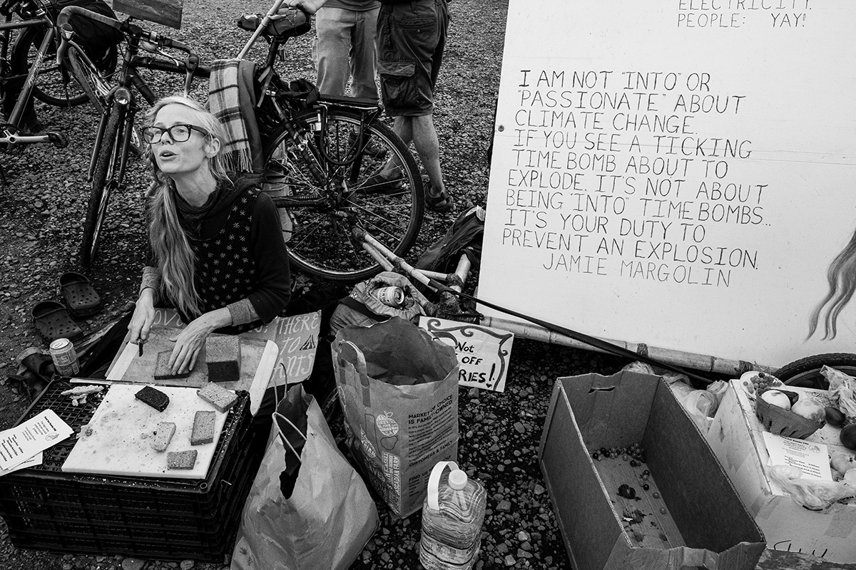 Portland Climate Strike: A representative of Food Not Bombs PDX handed out vegan food at the Climate Festival at OMSI.