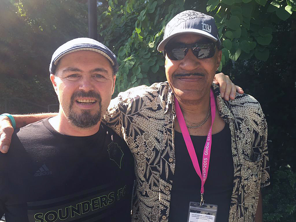 Street Roots vendor Desmond Hardison shares a pose with a new friend, Henrik Søndergaard Pedersen, a vendor for Hus Forbi street magazine in Copenhagen, Denmark. Street paper delegates from all around the world gathered in Seattle, Washington in June for
