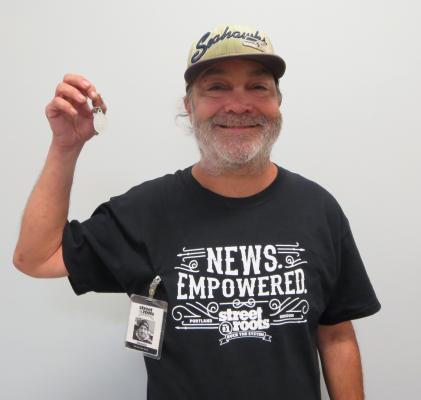 Street Roots vendor Dennis shows his apartment key