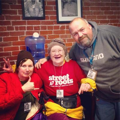 Vendors Andi Howard, Paulette Bade and Allen Bennet smile for the camera at the Street Roots office.