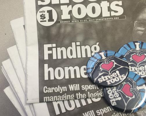 Street Roots newspaper and buttons