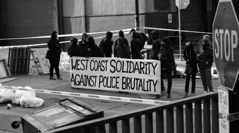 A group protests police brutality in April 2010 at the corner of NW 13th Avenue and Everett Street in downtown Portland Oregon, where James Chasse came into contact with police on Sept. 7, 2006.