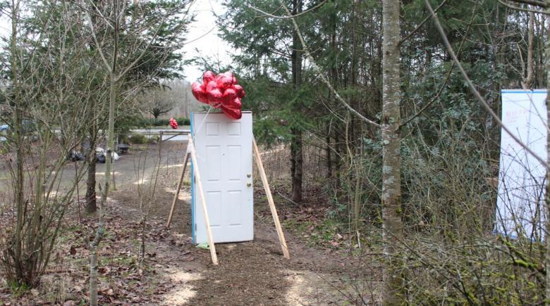 Door marks entrance to Village of Hope homeless camp