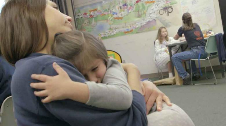 "A still frame from Brian Lindstrom's documentary ""Mothering Inside"""