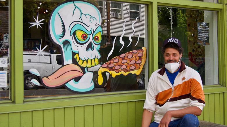 Eli Johnson outside of Atlas Pizza