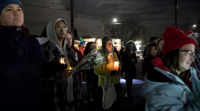 People gather at a candlelight vigil