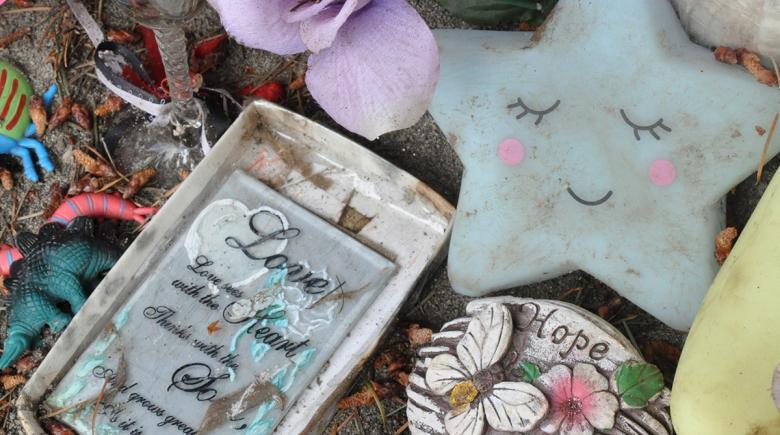 Trinkets and memorabilia at a memorial