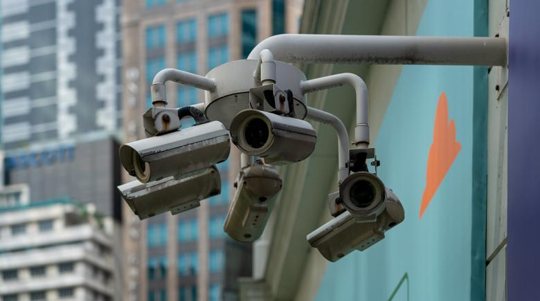Photo of multiple surveillance cameras mounted onto a wall