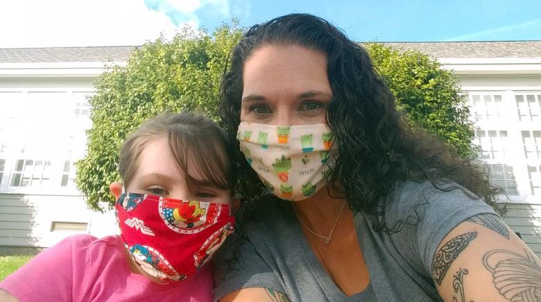 Deedra Martin and daughter Ellie wearing masks