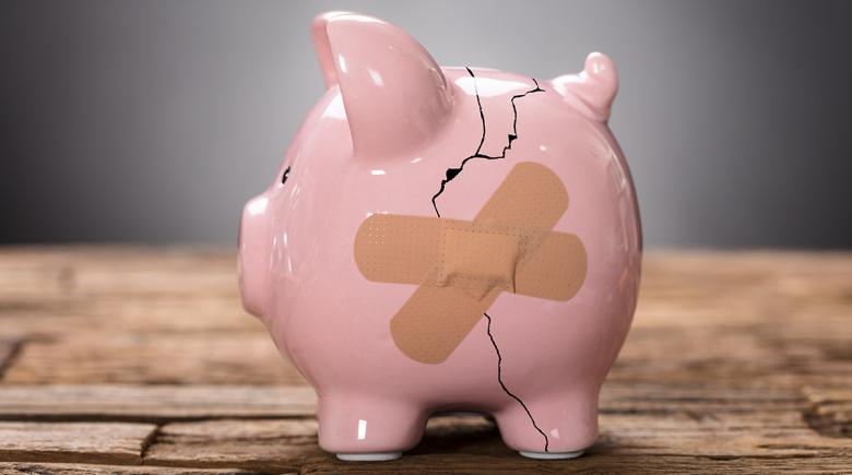 Broken piggy bank with a bandage
