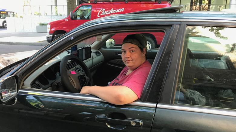 Chris Drake sits in his car