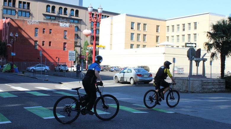 A private patrol officer and Portland Police officer patrol together downtown on Aug. 16
