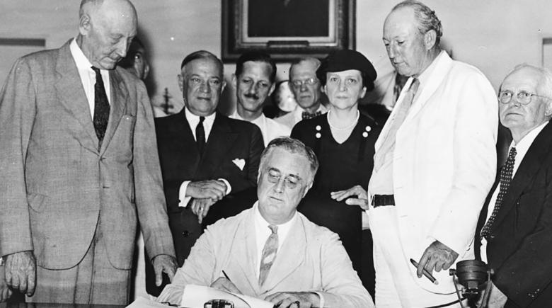 President Franklin D. Roosevelt signs the Social Security Act