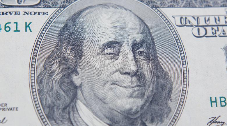 Illustration of $100 bill with Benjamin Franklin winking